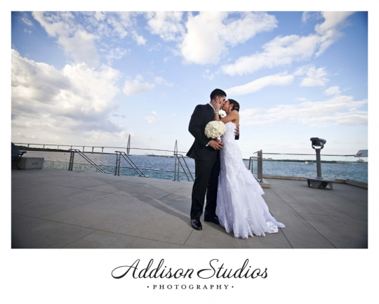 Bride and Groom Kiss in front of Charleston Bridge